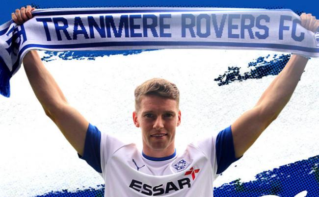 Tranmere Rovers have signed defender Calum Woods on one-year contract