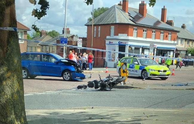 Motorcyclist taken to hospital after crash in Birkenhead