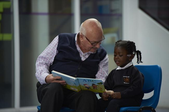 Could you become a reading volunteer for youngsters in Wirral?