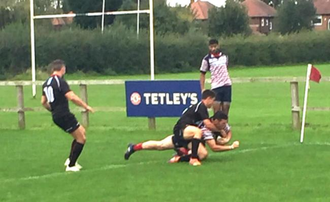 Prop Liam Sharples diving over for his try for Birkenhead Park against Bowden. Picture: John Horwood