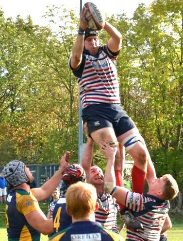 Birkenhead Park's Jack Ashcroft soars in the line out at Keswick. Picture by Ben Challis