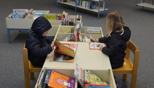 The collaboration will see new, high-quality books distributed across Wirral communities via schools, libraries and healthcare visits