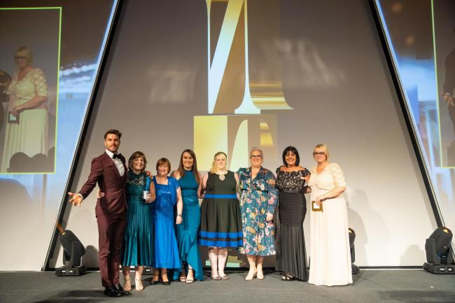 The Macmillan Urology Service who won the Cancer Nursing category at the Nursing Times Awards 2019 pictured with awards host TV presenter Joel Dommett