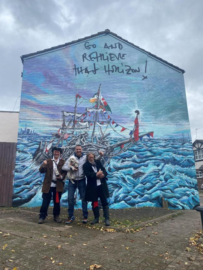 Major Mace, Daniel Davies (archie the dog) and Frank Lund in front of the new mural