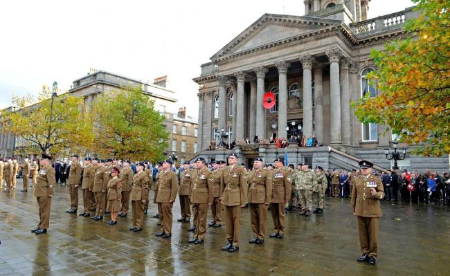 Armed forces stand in front of Birkenhead Town Hall during last year's Remembrance Sunday service. (Picture: Paul Heaps)