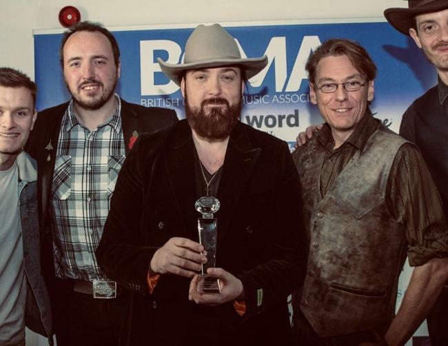 Stevie O'Connor pictured with his UK Country Entertainer of the Year Award at the BCMAs