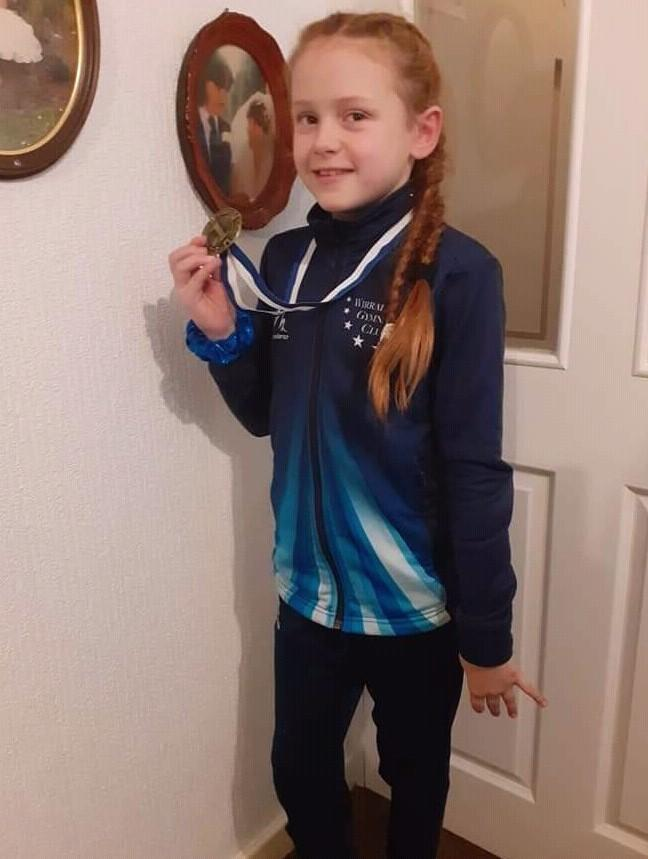 Rock Ferry Primary School pupil Emeila Grace Foy with her gold medal