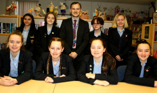 Teacher of English and Media, Tom Devling with some of the talented students who will have their poems published.