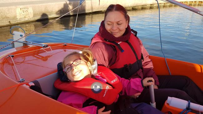 Amelia and her mum Sylwia on Rhyl Marine Lake in All Afloat's accessible boats