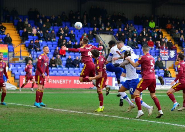 Manny Monthe heads home Tranmere's opener against Ipswich Town at Prenton Park