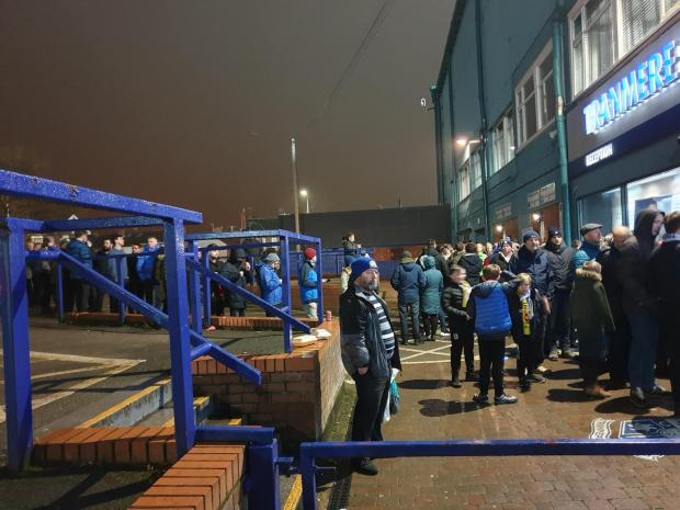 Wirral Globe: Supporters queuing outside the ticket office for Manchester United tickets at 11:30pm on Thursday night, straight after the Watford match. Photo: Richard Garnett