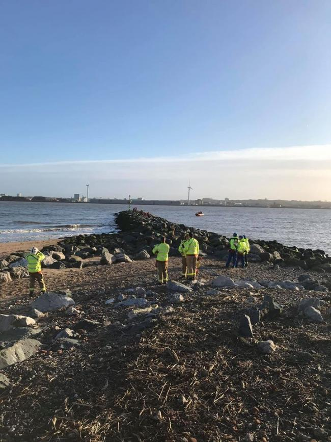 Emergency services worked together to rescue the woman from the rocks. Photo: Wirral Coastguard Rescue Team