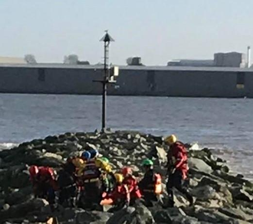 Wirral Globe: Rescuers used a special technique to safely remove the stretcher from the rocks. Photo: Wirral Coastguard Rescue Team