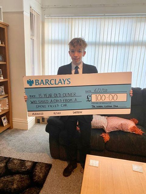 Bebington Co-Op Academy pupil Oliver, 15, with his reward from the Wirral Copper Jar