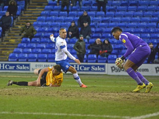 Wirral Globe: James Vaughan shoots into the hands of Jamal Blackman. Photo: Tony Coombes