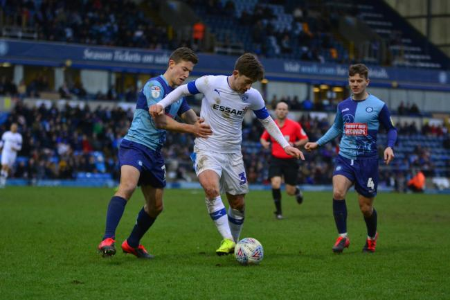 Alex Woodyard on the ball for Tranmere against Wycombe Wanderers. Photo: Tony Coombes