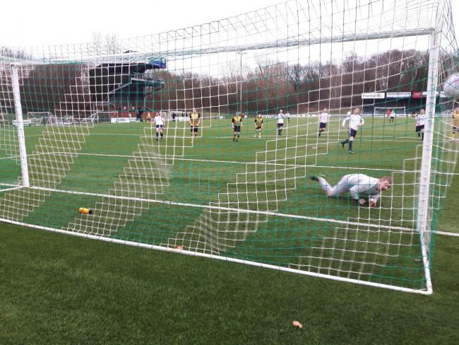 Ryan Cox scores his penalty against St. Martins. Photo: Alan Bartlam