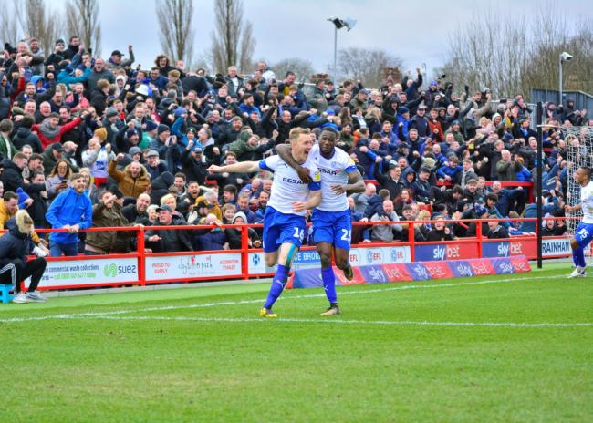 Mark Ellis wheels away with delight after putting Tranmere 2-0 up as supporters celebrate. Photo: Tony Coombes