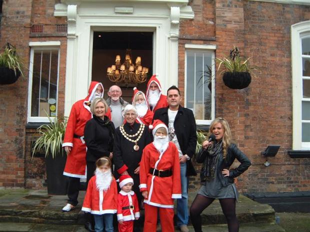 Wirral Globe: Marie-Clare Scott meets runners and organisers Andrew Williams, Councillor Keith Cafferty, Sally Capener, Michael Oakes, Sue Togay, Mayor of Nantwich Edith Williams, Paul Newman, Santa mascots Morgan Zwijnen, Ross Williams and Cameron Oakes.