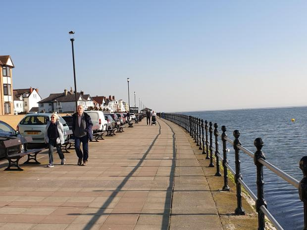Wirral Globe: Plenty of cars at West Kirby promenade but walkers were well spaced out. Photo: Richard Garnett