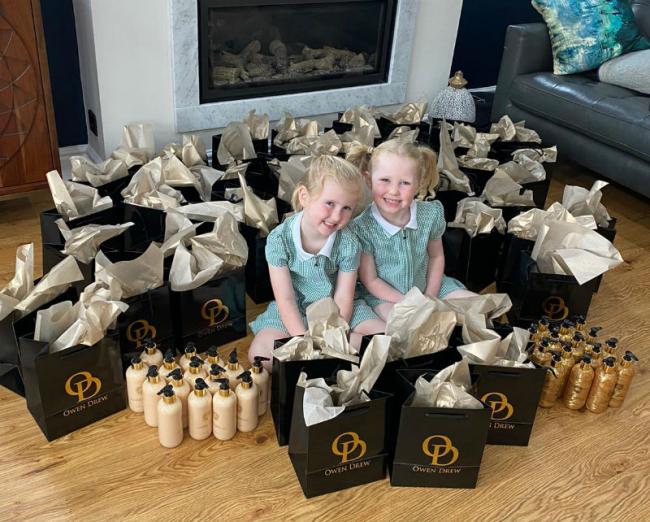 Claire and Benn Carson's daughters Eva, six, and Lara aged four help pack up the parcels later given to staff at Wirral Hospice St John's