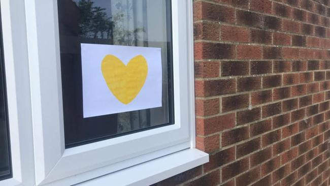 The moving reason why you might see yellow hearts in windows. Image: Hannah Gompertz