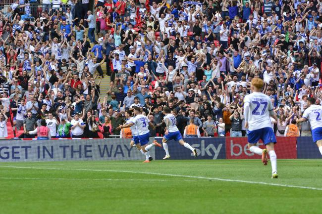 Fans celebrate Connor Jennings' late Wembley winner in the League Two play-off final in 2019. Photo: Tony Coombes
