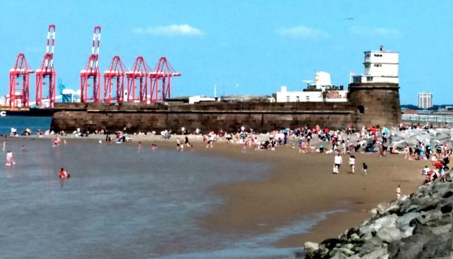 Sunseekers near Fort Perch Rock in New Brighton this afternoon. Picture: Craig Manning