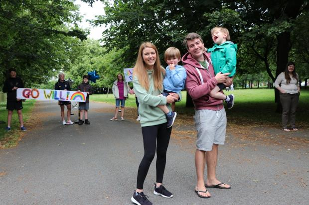 Wirral Globe: The Ritchie family celebrate after Will (green jacket) finished his walking marathon. Photo: Richard Garnett