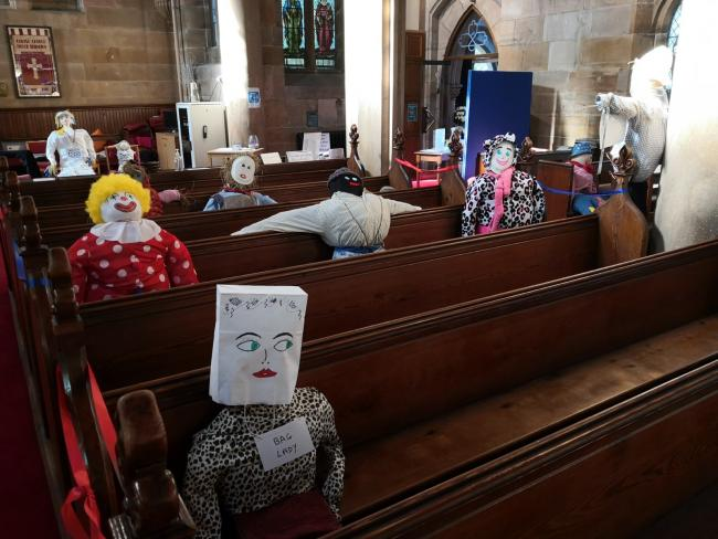 The Church has been filling out its pews with scarecrow parishioners