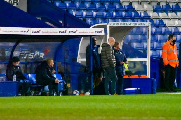 Wirral Globe: Keith Hill gets used to the Prenton Park dugout. Photo: Phil Bryan