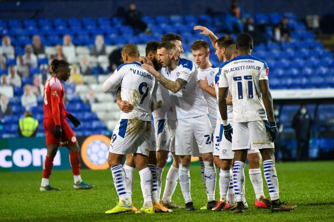 Tranmere's players congratulate Kaiyne Woolery after his second half goal. Photo: Phil Bryan