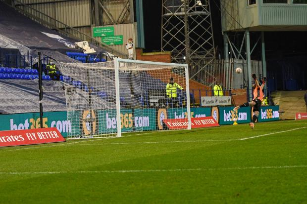 Wirral Globe: Kaiyne Woolery's strike sails past Danny Lewis to make it 1-0 to Tranmere. Photo: Phil Bryan