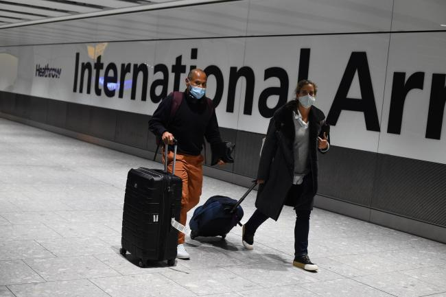 Travellers arrive at the airport