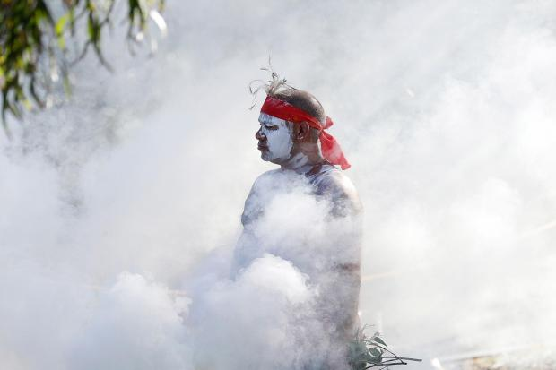 Russell Dawson of the Koomurri Aboriginal Dancers participates in a smoking ceremony during Australia Day ceremonies in Sydney