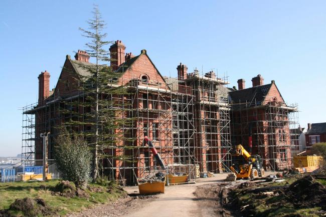 Scaffolding wraps around Andrew Gibson House as the restoration takes shape