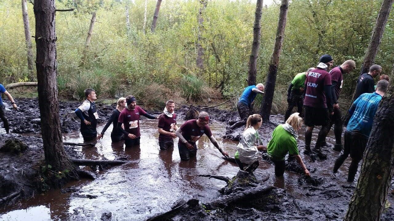 Team Noamd racing through the mud