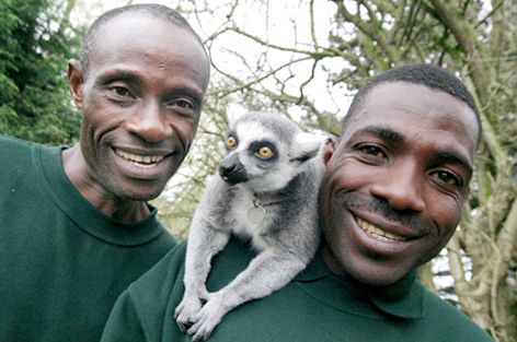 CARING: Andreas Mbong and Bama Alfred with a lemur