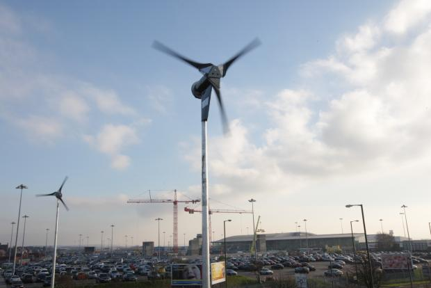 STANDING TALL: JLA's wind turbines located on Speke Hall Road with JLA terminal building and car parks in the background