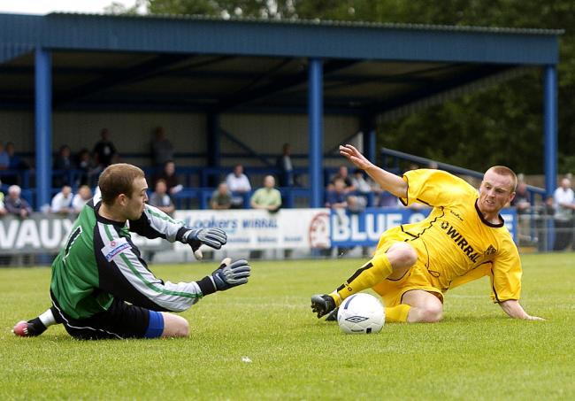 THAT'S MINE: Vauxhall goalkeeper Sean Lake saves at the feet of a Tranmere Rovers player