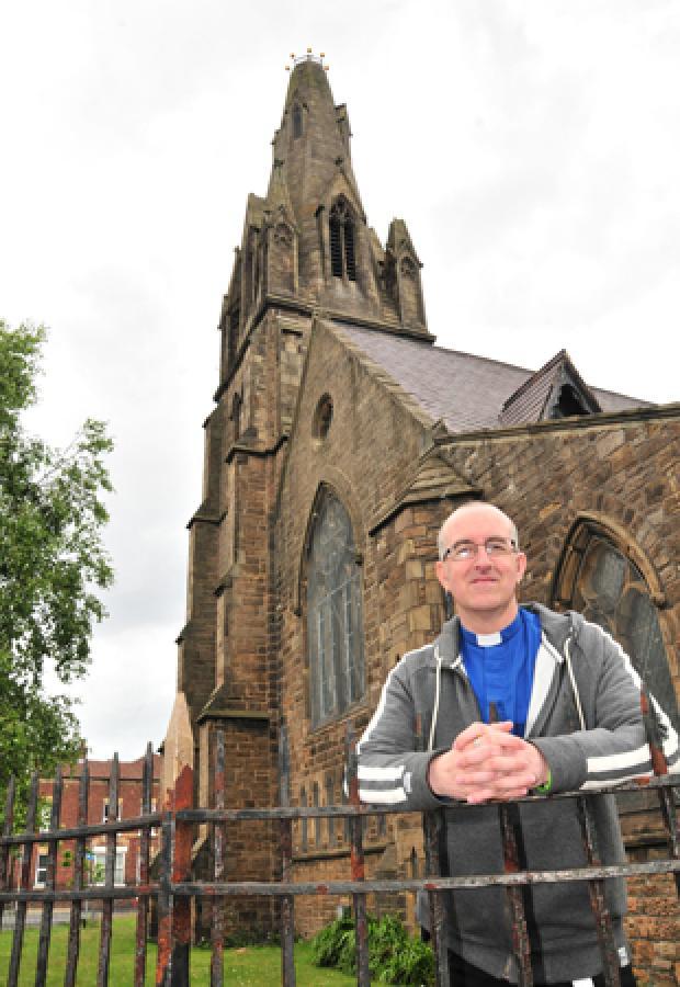 Rev Ian Hughes outside St Paul's church in June 2011