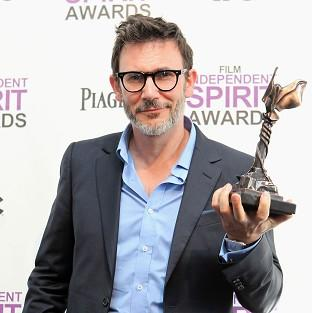 Michel Hazanavicius with the award for best director for The Artist at the Independent Spirit Awards (AP/Joel Ryan)