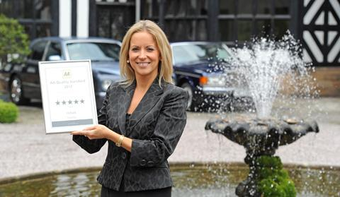 Claire Jones with certificate confirming The Hilbark's five star rating. Picture: Paul Heaps