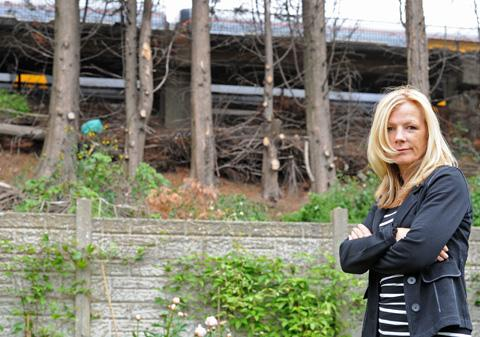FLASHBACK: Concerned resident Tracy Hitchmough in her garden where trees have been cut down