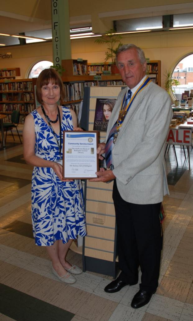 Claire Oxley, senior library manager and Mike Ashton, president of Bebington Rotary Club