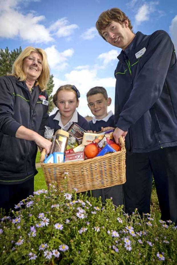 Pupils Robyn Purser and Josh Harding receive a prize hamper and a £100 donation for school funds from Co-operative Food store managers, Margi Trueman and Craig Boote.