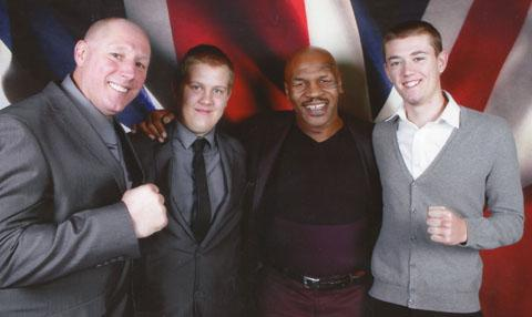 Mike Tyson with Kenny Rainford and his sons Michael and Lee during visit to Wirral