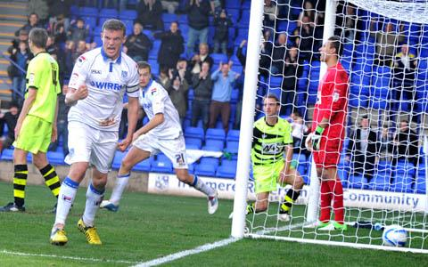 Danny Holmes scores the winning goal for Rovers. Picture: Paul Heaps