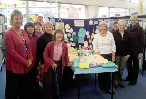 Jan Walton (far right) with Purls of Wisdom knitting group
