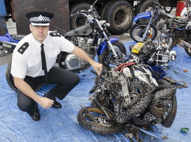 Flashback: Merseyside Police Inspector Phil Ross with a scrambler seized and sent through a crusher in a similar crackdown in 2012